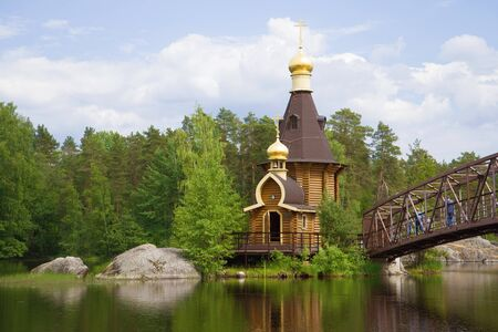 View of the Church of the Apostle Andrew the First Called on the Vuoks River on a sunny June day. Russia, Leningrad region