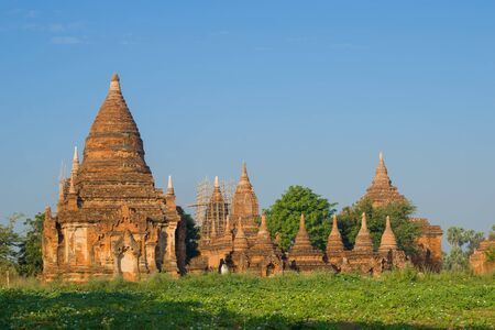 View of the ancient Buddhist temple complex on a sunny morning. Bagan, Myanmar (Burma) Фото со стока