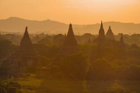 Buddhist temples of ancient Bagan on orange evening. Burma (Myanmar) Фото со стока
