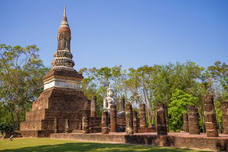 Sculpture of a sitting Buddha on the ruins of an ancient Buddhist temple in the historical park of Sukhothai. Thailand