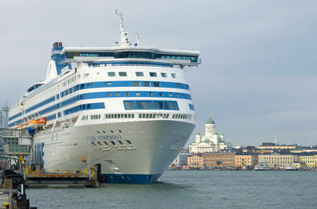 """HELSINKI, FINLAND - MARCH 08, 2019: The sea cruise ferry """"Silja Symphony"""" close up in the harbor of Helsinki in the cloudy March afternoon Editorial"""