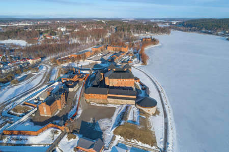 Above the old fortress-prison Hameenlinna on a sunny March day (aerial photography). Finland