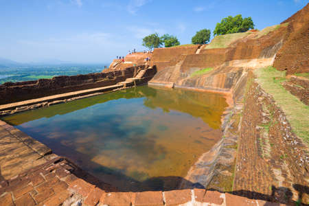 View of the central pool of the ancient royal palace on top of Sigiriya Mount. Sri Lanka Editorial