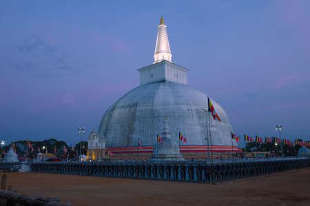 View of the Ruwanweli Maha Seya dagoba in the evening twilight. Anuradhapura, Sri Lanka