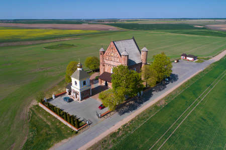 The ancient church of St. Michael on a sunny May day (aerial survey). Synkovichi, Belarus