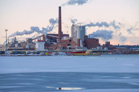 KOTKA, FINLAND - MARCH 10, 2020: View of the Sunila Pulp and Paper Mill on a March evening Editorial