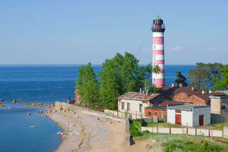 View of the old Shepelevsky lighthouse on a sunny June afternoon. Leningrad region, Russia