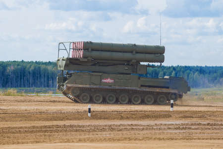 MOSCOW REGION, RUSSIA - AUGUST 25, 2020: Launcher 9A316M of the Buk-M3 anti-aircraft missile system on the GM-5969 7-roller chassis at the training ground. Fragment of the demonstration program of the international military forum
