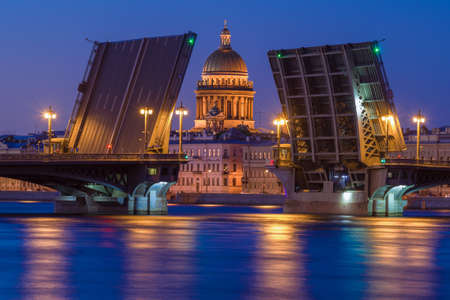 The dome of St. Isaac's Cathedral in the alignment of the divorced Annunciation bridge on a white night. Saint Petersburg, Russia