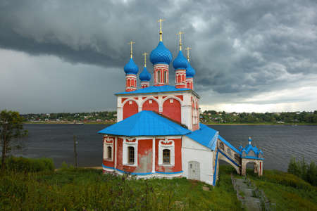 The old church of the Kazan Icon of the Mother of God over the stormy sky. Tutaev, Russia Stok Fotoğraf
