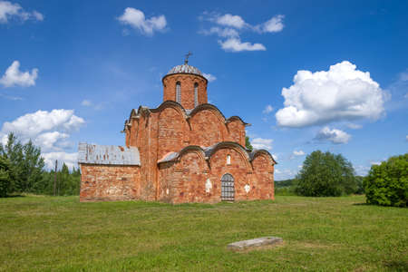 Old Orthodox Church of the Transfiguration of the Savior on Kovalevo in the summer landscape. Surroundings of Veliky Novgorod, Russia