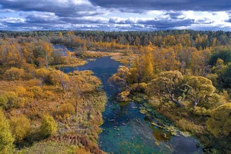 Beautiful view of the Izvarka river in golden autumn.