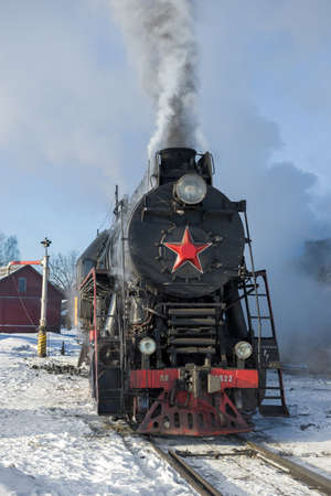SORTAVALA, RUSSIA - MARCH 10, 2021: Freight main Soviet steam locomotive LV-0522 close-up. Front view