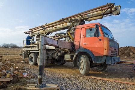 LENINGRAD OBLAST, RUSSIA - MARCH 28, 2021: Concrete pump based on Kamaz car on construction site