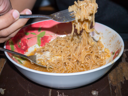 Instant noodle eat with fork and spoon