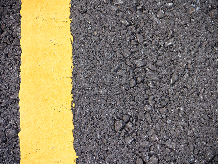 yellow line: Road surface and yellow line Stock Photo