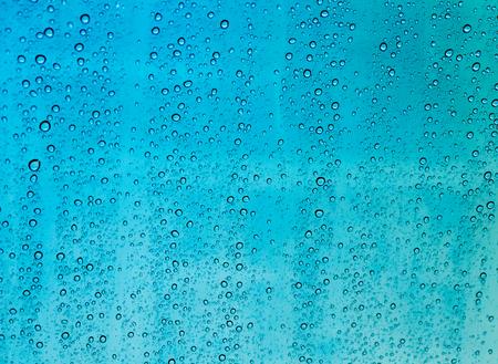 auto glass: Drops of rain on a window glass,rain drop on auto glass in rainy day