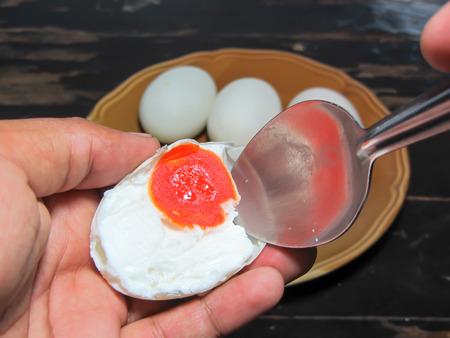duck egg: salted egg,salted duck egg on dishspoon Stock Photo