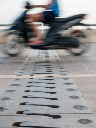 motorcycle officer: motorcycle rider cross the bridge motion blur