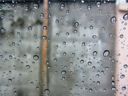 auto glass: rain drop on  auto glass in rainy day view in side car Stock Photo