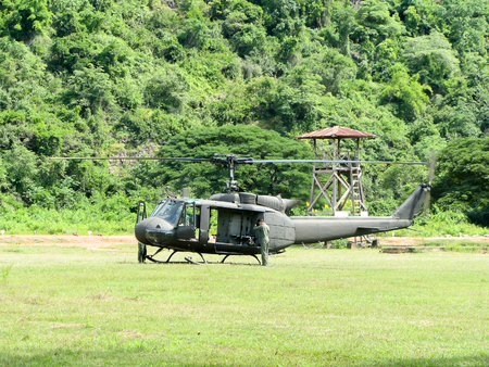 infantry: Prachuap Khiri Khan,Thailand, NOV 15 2012 : Helicopter UH-1 Huey start engine in Infantry Center  for military training where is beside mountain
