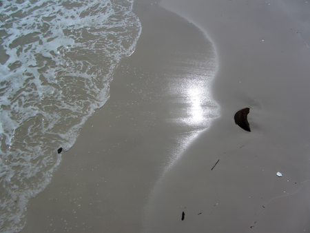 reflective: Wave Of the sea water On Sand Beach,reflective light from the sun
