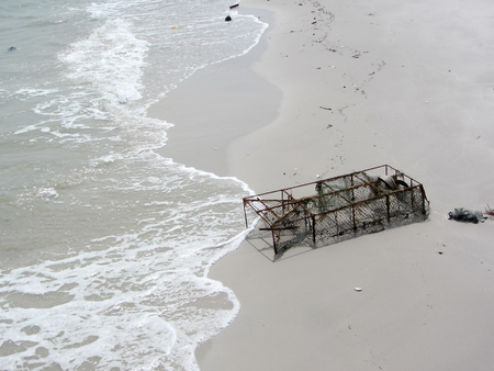 crab pot: Old Crab trap in sand beach,old lobster and crab pot on seaside