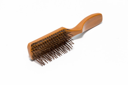 Comb ever used on white background Stock Photo