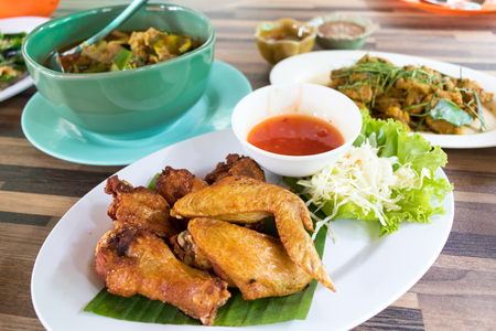 fried chicken wing and vegetables on plate
