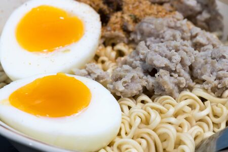 Instant noodles in bowl with boiled egg and minced pork Stock Photo