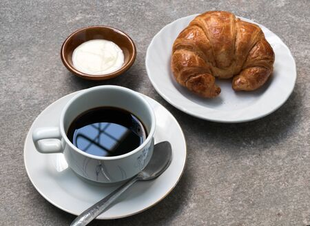 black coffee with Croissant bread Stock Photo