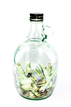 Save money in a glass jar on white background Stock Photo