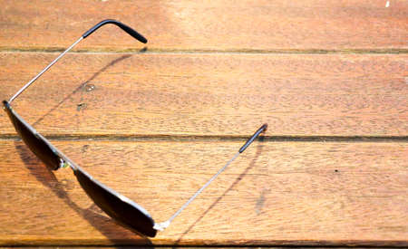 Sunglasses placed on wooden boards