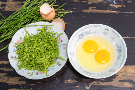 Acacia Pennata with egg to make omelet on wooden background Stock Photo