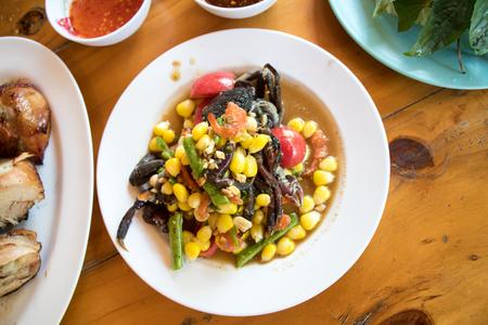 Corn papaya salad with field crab is spicy thai food Stock Photo