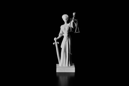 Lady Justice on black background isolated Banque d'images - 129264473