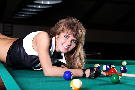 snooker hall: a young woman playing billiard Stock Photo
