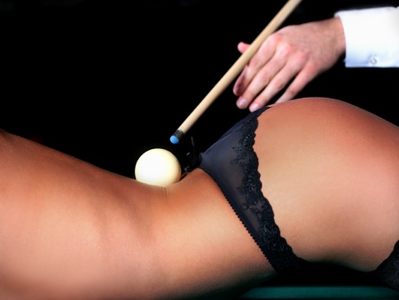 white billiard ball lying on his back naked female body photo