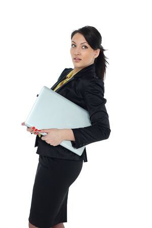 Portrait of young beautiful brunnete woman holding laptop - isolated on white Stock Photo - 12745923
