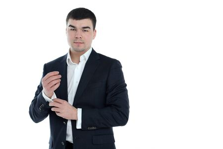 Portrait of a young businessman standing against isolated white background Stock Photo - 12745956