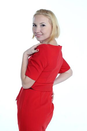 portrait of blonde girl in red dress isolated on white background photo