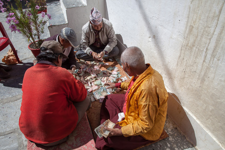 Counting money, Marpa gompa, Mustang, Nepal.
