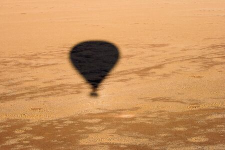 namib: Hot Air Balloon Shadow. Sesriem canyon, Namib Desert, Namibia. Stock Photo