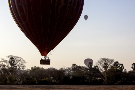 Hot air balloons over plain of Bagan in misty morning, Myanmar