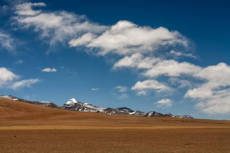 hillsides: Dark cloud over Tibetan hillsides beyond Lake Manasarovar-Kora, Tibet, China.