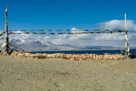 Prayer flags and Mani stones outside Seralung Monastery, Lake Manasarovar-Kora, Tibet