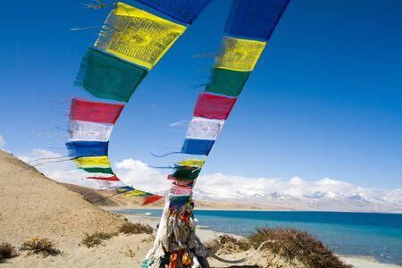 Prayer flags at the Stupa at Seralung Gompa Monastery at Lake Manasarovar.  Lake Manasarovar is beautiful and it is the most sacred lake for Tibetans. Tibet, China.