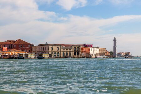 Vibrant  buildings and  Lighthouse in Murano island,  Venice, Italy.