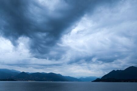 Lake Maggiore is a long, thin lake on the south side of the Alps,