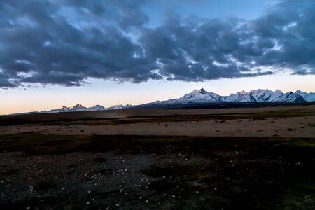 Tibetan landscape and Gang Benchnen North 7416 m at sunset, Tibet, China.